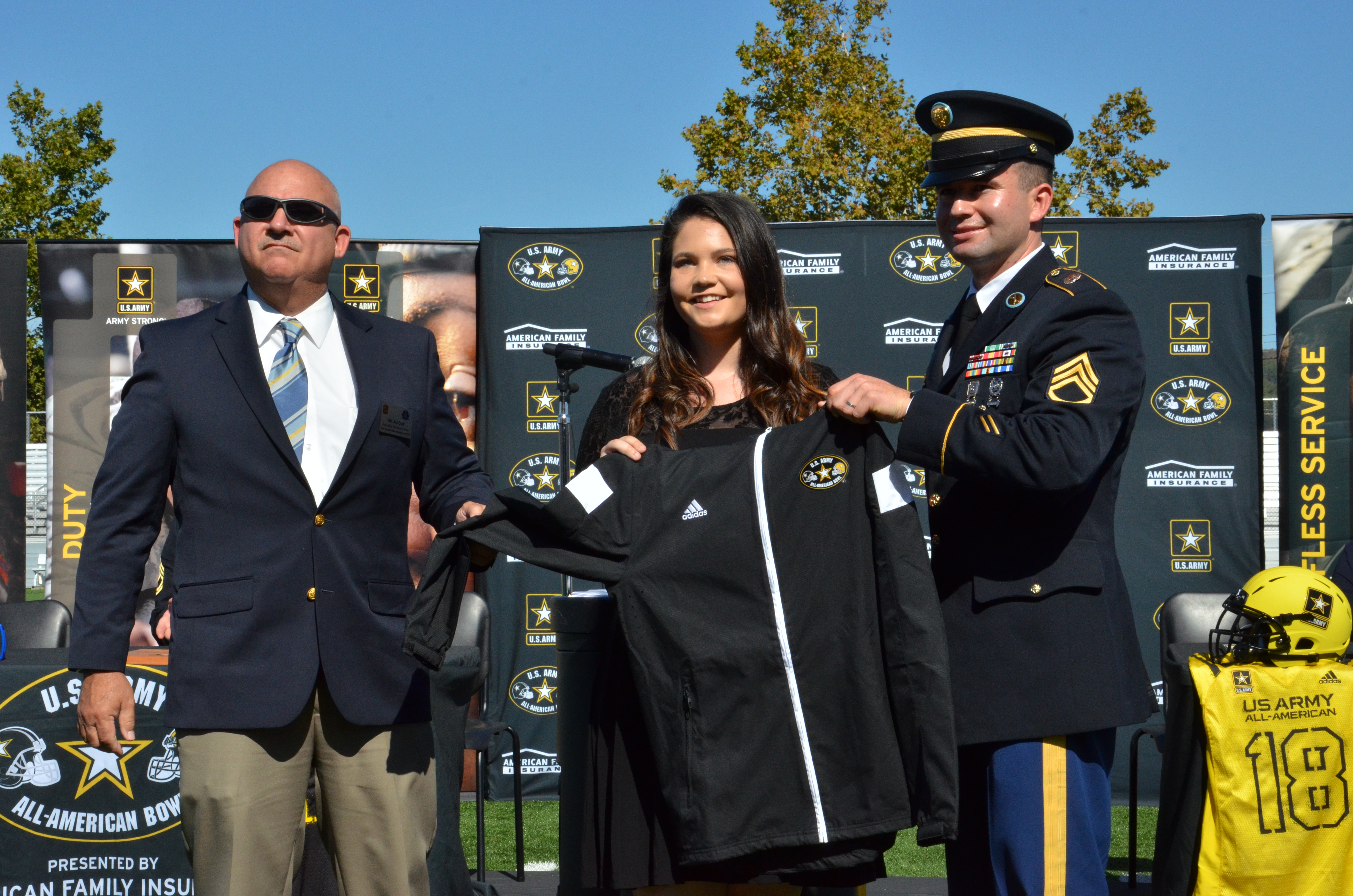 A. J. Cox and Rigoberto Portillo present jacket to Bowers
