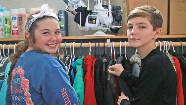 Star Photo/Curtis Carden T.A. Dugger Junior High students Caitlin Taylor (left) and Nolan Chambers are hoping to expand the idea of a clothing/supply closet to help the student population at the school.